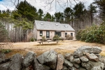Charming Maine stone walls line the property
