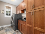 Main level Laundry with Wash Sink and Storage