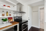 Gorgeous subway tiles and fun open shelving
