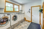 Laundry with countertop sink and garage access