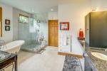 Spa-like owners bath with warming towel racks