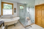 Claw foot tub and glass enclosed shower