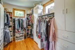 Walk in closet with built ins galore!