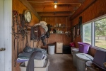 Large tack rooms in each barn too!
