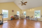 Huge vaulted playroom living room or master suite