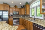 Stainless appliances and tile backsplash