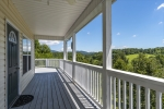 Covered front porch leads to wraparound deck