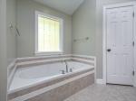 Soaking tub and 2 walk-in closets