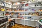 Expansive walk-in pantry with room for appliances