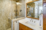 Owners bath features beautiful glass shower