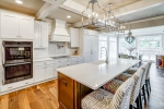 Coffered ceiling and built-in appliances shine!