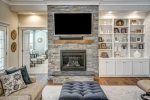 Soapstone fireplace with raised hearth is stunning