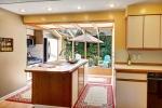 Inviting Kitchen with sunny atrium windows