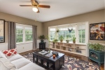 Large windows and hardwoods throughout home