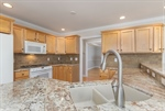 Beautiful stone countertops and backsplash accents