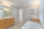 Two separate master bath vanities
