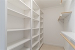 Great master walk-in closet off of the bath