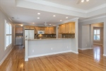 Open livingkitchen area w beautiful hardwoods