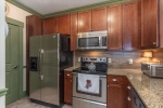 Stainless appliances and laundry off of kitchen.
