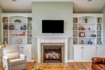 Gas fireplace with built in storage surround