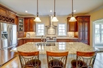Granite counters and cherry cabinets shine!