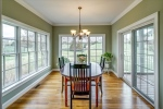 Sunny dining room with french doors to porch