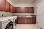 Amazing built-in storage and sink in laundry room!