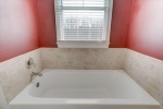Expansive soaking tub in owners bathroom