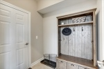 Mudroom with access to garage