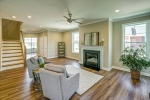 Great room with gas fireplace and ceiling fan
