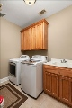 Large laundry room with a sink