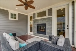 Screened porch with dual sided gas fireplace