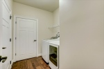 Enter from 2 car garage into laundry room