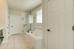 Linen closet and water closet in owners bath