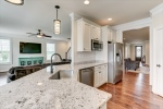 Bright and cheery kitchen with gleaming granite