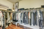 Large walk-in closet located in owners bath