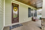 Covered front porch with stained beadboard ceiling