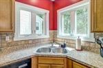Corner sink with back yard views