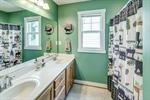 Full bathroom with double vanities
