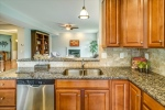 Beautiful granite counters and tile backsplash