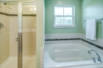 Large soaking tub and shower in owners bathroom