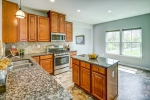 The chefs kitchen features cherry cabinets