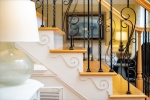 Custom wood work and iron balusters on stairs
