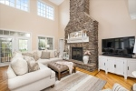 Great room with stone gas fireplace surround
