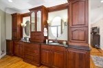 En suite bath with granite and custom cabinetry