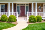 Wide covered front porch welcomes guests