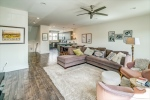 Large great room with ceiling fan