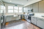 Kitchen features painted maple cabinets