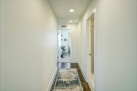 Third level hall leads to laundry and 2 bedrooms