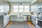 Granite counters and stainless appliances shine
